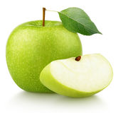 Green apple with green leaf and apple slice isolated on white stock image