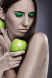 Green apple and green make up Royalty Free Stock Images