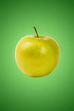 Green apple on green Royalty Free Stock Images