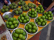 Green apple guava and Sugar apple being sold in market by plate. Tropical fruits Green apple guava and Sugar apple being sold in market by plate. Both are Royalty Free Stock Photography