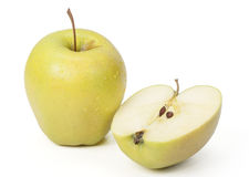 Green apple and half an apple. Green apple and half an apple on a white background Royalty Free Stock Image