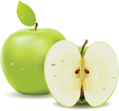 Green apple and half of apple. Fresh green apple with leaf and half of apple on white background Stock Photography