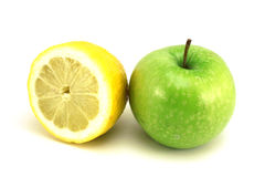 Green apple and half a lemon Royalty Free Stock Image