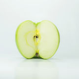 Green apple half on white. Background Royalty Free Stock Photos