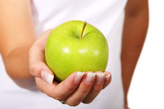 Green apple in hand. Young woman holding fresh green apple in her palm Royalty Free Stock Photos