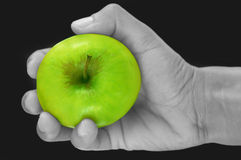 Green apple in a hand Royalty Free Stock Images