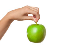 Green apple in hand Royalty Free Stock Image