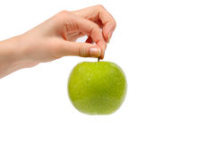 Green apple in hand Stock Photography