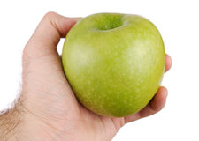 Green apple in a hand. On a white background Royalty Free Stock Images