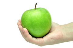 Green apple in a hand Stock Photos