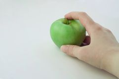 Green apple in the hand. Apple in the hand on a white background stock photo