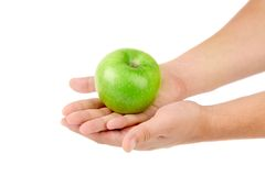 Green apple on hands. Royalty Free Stock Image