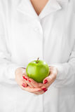 Green apple in hands Royalty Free Stock Images