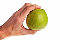Green apple hold by white male hand. Royalty Free Stock Photo