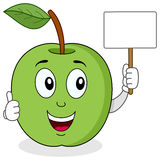 Green Apple Holding a Blank Banner Royalty Free Stock Photo