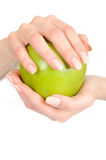 Green Apple In A Beautiful Hand Of Woman Stock Photo