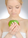 Green Apple In Beautiful Manicured Hand Of Woman Stock Images