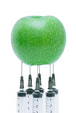 Green apple with  inserted syringe Stock Photography