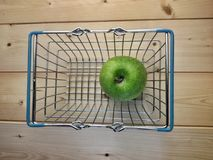 Green apple inside basket Royalty Free Stock Photography