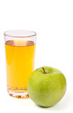 Green apple with juice Stock Images