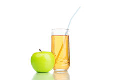 Green apple with juice isolated on white Royalty Free Stock Images