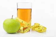 Green apple and juice with measuring tape Stock Photos