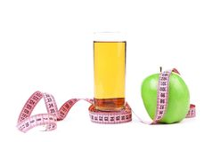 Green apple and juice with measuring tape Royalty Free Stock Photos