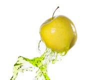 Green apple in juice stream Stock Image