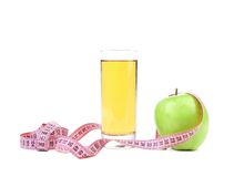 Green apple with juice and tape measure Royalty Free Stock Image