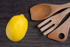 Green apple and kitchen wooden shovels Royalty Free Stock Images