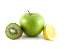 Green apple, kiwi and yellow lemon. Green apple and sliced kiwi and yellow lemon (white background). Fresh diet fruit (water drops). Healthy fruit with vitamins Royalty Free Stock Photo
