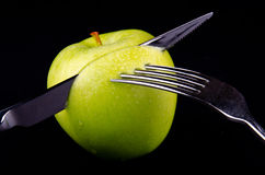 Green apple and a knife Royalty Free Stock Image