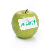 Green apple and label with the word healthy, isolated Stock Photography