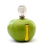 Green apple with a lamp and a battery Royalty Free Stock Photo