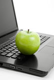 Green apple and laptop Royalty Free Stock Image