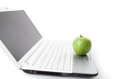 Green apple on laptop keyboard Royalty Free Stock Photography