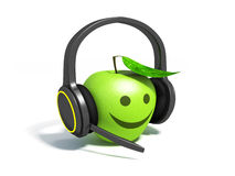 Green apple with leaf on headphones Royalty Free Stock Photos
