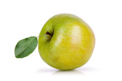 Green apple with leaf lying on its side on a white background Royalty Free Stock Photos