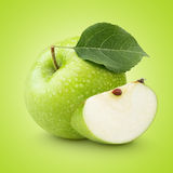 Green apple with leaf and slice Stock Image