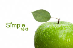 Green apple with leaf and water drops Royalty Free Stock Image