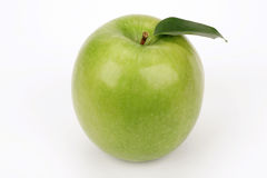 Green apple with leaflets. On a white background Royalty Free Stock Photography
