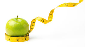 Green apple and leaving centimeters Stock Images