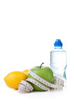 Green apple, lemon and bottle water with measuring tape Royalty Free Stock Photography