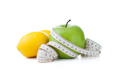 Green apple and lemon with measuring tape Royalty Free Stock Image