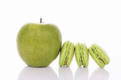 Green apple with macaroons Royalty Free Stock Images