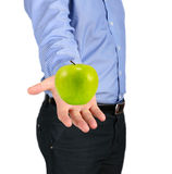 Green apple in a man's hand Royalty Free Stock Photo