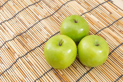 Green apple on mat Royalty Free Stock Images