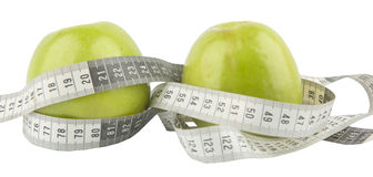 Green apple and measure tape Stock Image