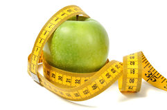 Green apple and measure tape Royalty Free Stock Photo