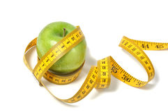 Green apple and measure tape Royalty Free Stock Image
